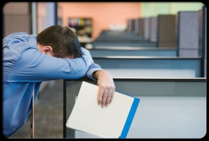 sleep-disorders-s16-man-rsting-head-in-office