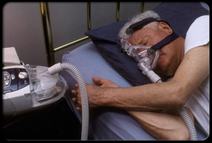 sleep-disorders-s19-man-with-cpap-device